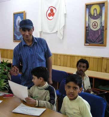 Painting class: Teacher with his students
